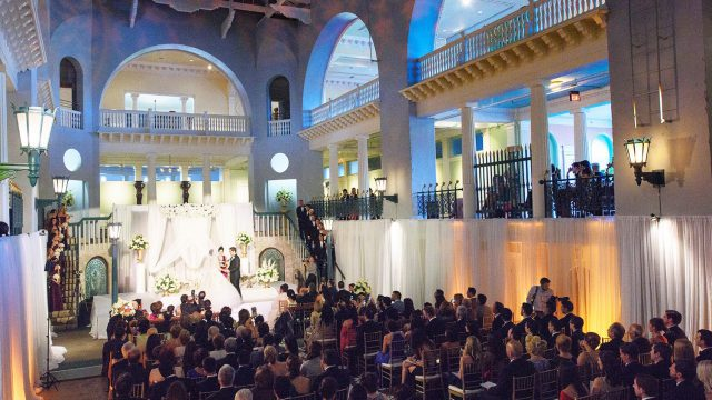 Wedding ceremony in the historic pool at the Lightner Museum