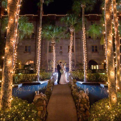 Bride and groom in Lightner Courtyard St. Augustine