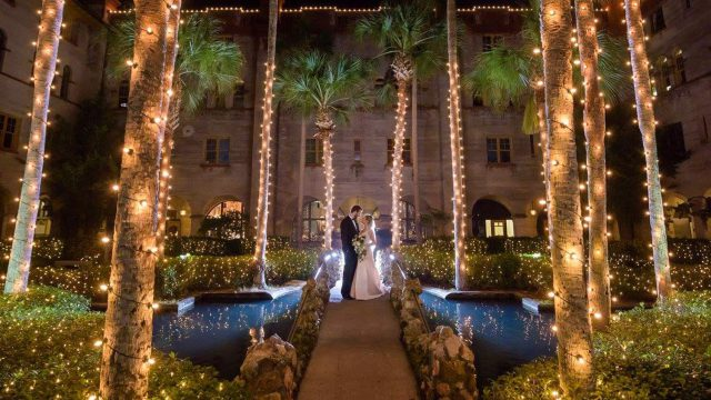 Bride and groom in Lightner Courtyard St. Augustine