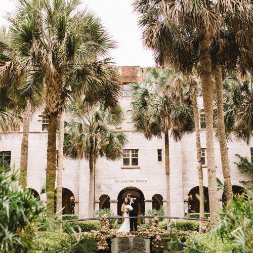 Bride and groom in courtyard of Lightner Museum