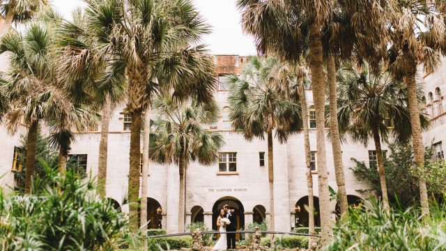Bride and groom in courtyard of Lightner Museum