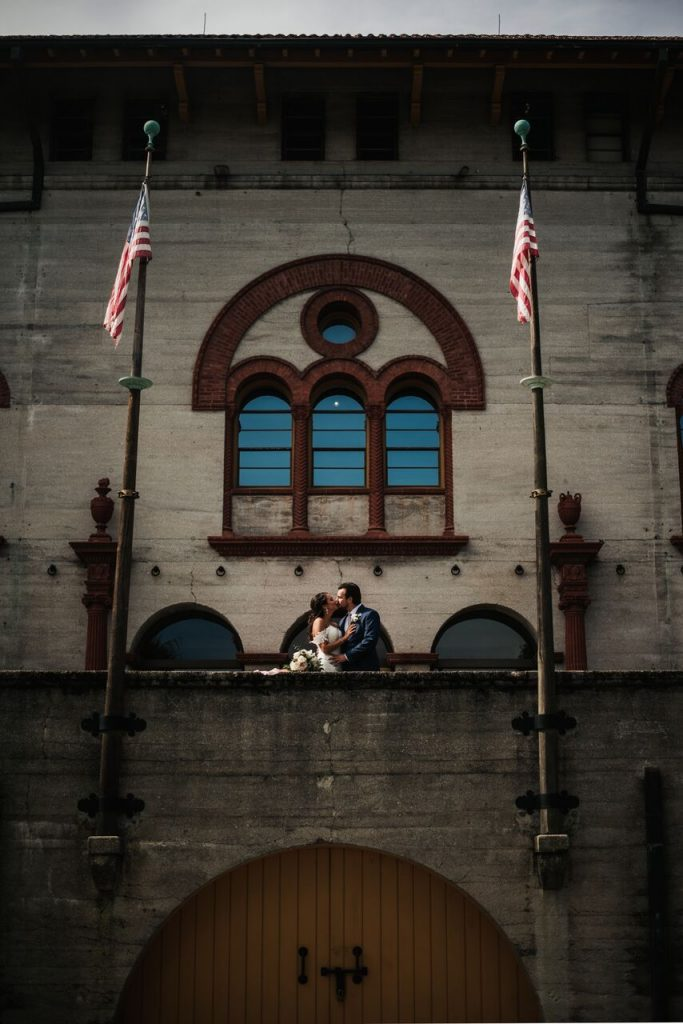 Bride and Groom on terrace at Lightner Museum in St. Augustine
