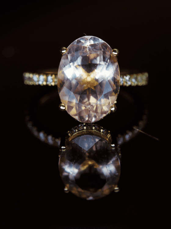 pale pink morganite oval ring surrounded by diamonds