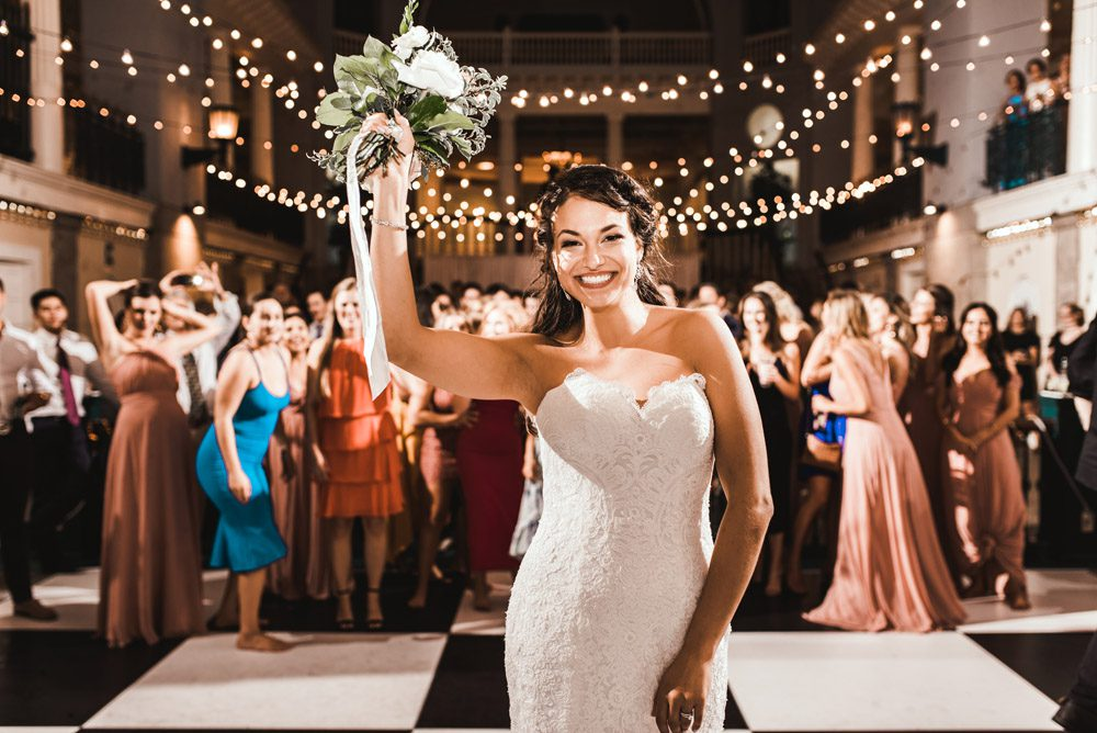 Bouquet Toss   Brooke + Blake   A Magical St. Augustine Wedding at the Lightner Museum