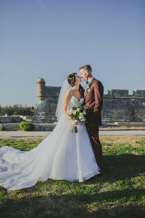 Wedding photos in front of the fort in St Augustine Florida