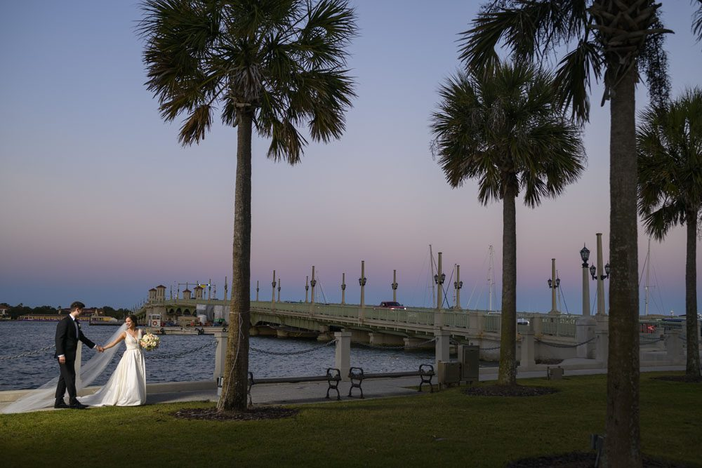 Bride and Groom in Front of the Bridge of Lions in St. Augustine